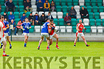Brendan O'Keeffe Rathmore is tackled by Patrick Daly Laune Rangers during their IFC clash in Killarney Friday evening