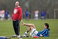An MSW (Army & Navy) FC footballer takes a break during a Hackney & Leyton League match on at Hackney Marshes - 24/01/10 - MANDATORY CREDIT: Gavin Ellis/TGSPHOTO - Self billing applies where appropriate - Tel: 0845 094 6026