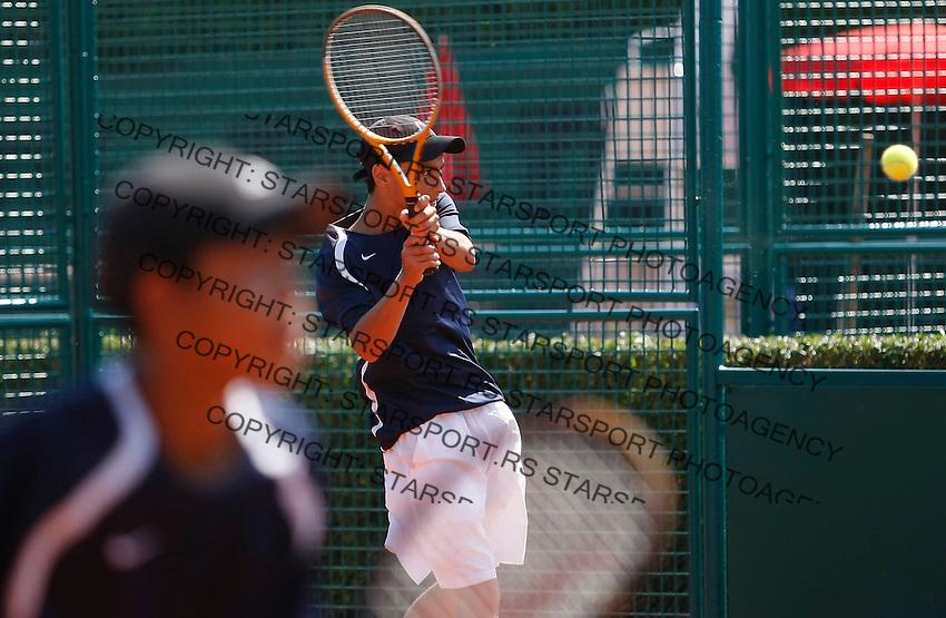 Tenis, World Championship U-14.USA Vs. Korea, boys.Rubin Noah and Belga Jordan Vs. Geon Ju Shin and Hyeon Chung.Rubin Noah, returnes.Prostejov, 02.08.2010..foto: Srdjan Stevanovic/Starsportphoto ©