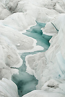Melted ice forms a beautiful green waterways on the surface of Franz Josef Glacier - Westland National Park, West Coast
