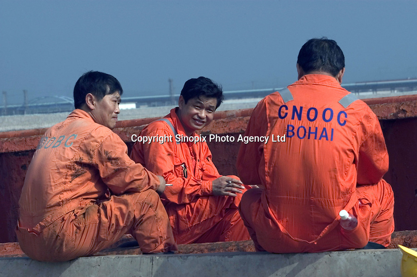 Oilfield Services Workers of  China National Offshore Oil Corporation's (CNOOC) have a rest while preparing supplies for oil rigs in China's Liaodong Bay of the Bohai sea in Tianjin, China..