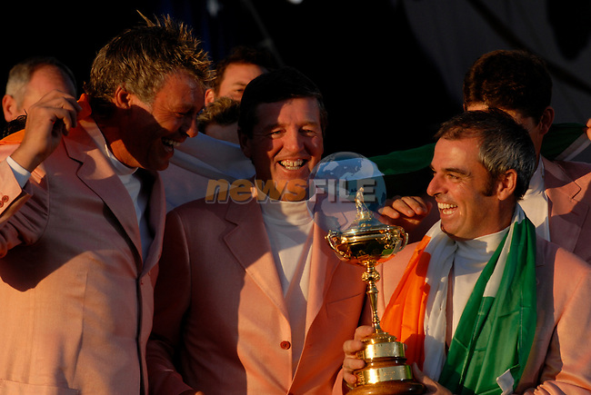 Irish members, Darren Clarke, Des Smyth vice-captain and Paul McGinley, part of the victorious European Team, hold the Ryder Cup during the closing ceremony of the 2006 Ryder Cup at The K Club..Photo: Eoin Clarke/Newsfile.