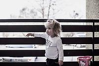 Maedchen spielt auf dem Balkon, HartzIV, Bochum<br /> <br /> <br /> *** HighRes auf Anfrage *** Voe nur nach Ruecksprache mit dem Fotografen *** Sonderhonorar ***<br /> <br /> Engl.: Europe, Germany, Bochum, unemployment benefit, Hartz IV, unemployed, unemployment, poverty, poor, social benefits, girl, child, playing on the balcony, portrait, 28 March 2012<br /> <br /> ***Highres on request***publication only after consultation with the photographer***special fee***