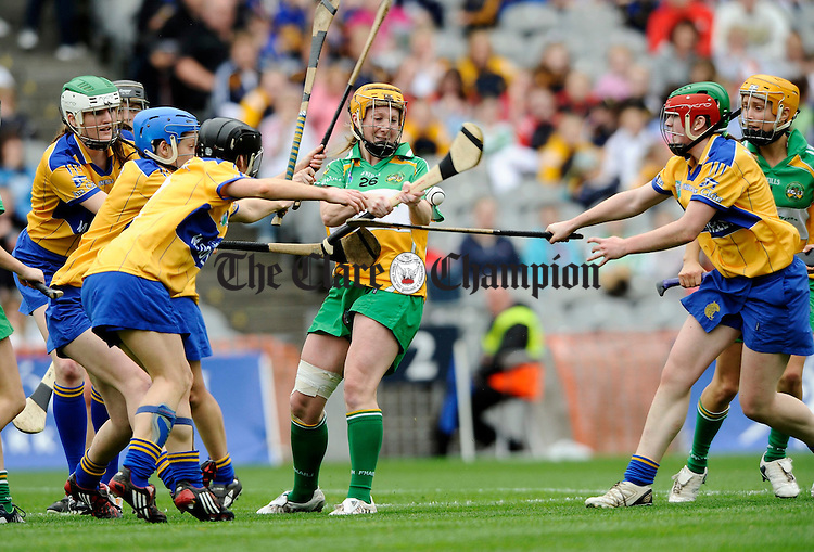 Offaly's Jeanette Feighery feels the pressure from the Clare defence during the All-Ireland junior camogie final at Croke Park. Photograph by John Kelly.