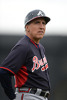 Atlanta Braves third base coach Doug Dascenzo (51) during a spring training game against the Detroit Tigers on February 27, 2014 at Joker Marchant Stadium in Lakeland, Florida.  Detroit defeated Atlanta 5-2.  (Mike Janes/Four Seam Images)