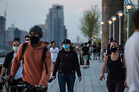 NEW YORK, NY - MAY 15: People walking through Domino Park using social distance and face masks on May 15, 2020 in Brooklyn, NY. COVID-19 has spread to most countries in the world, claiming more than 303,000 infected lives for more than 4.5 million people, although in some cities the pandemic has controlled deaths and infections continue. Mayor Bill de Blasio says the city, along with New York police, will launch a pilot program in public parks this weekend to monitor crowds (Photo by Pablo Monsalve / VIEWpress via Getty Images)
