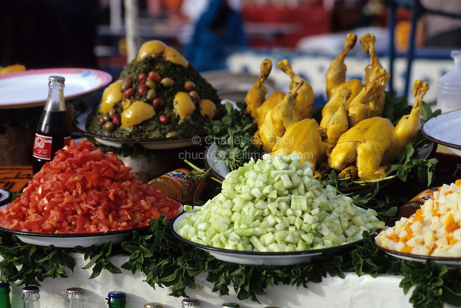 Marrakesh, Morocco - Food for Sale, Place Jemaa El-Fna.  Chucken, Tomatoes, Cucumbers, Potatoes, Carrots, Soft Drinks.