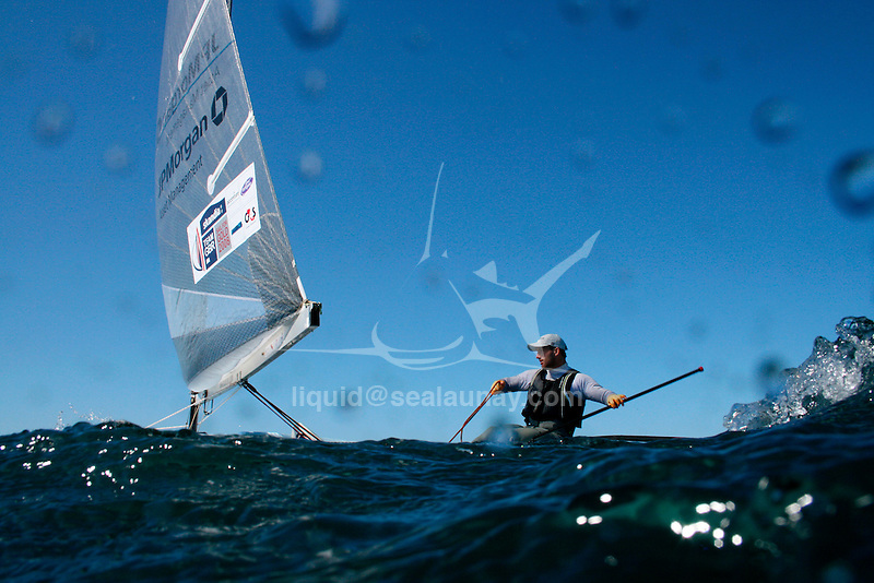 """Finn champion Ben Ainslie on a training session in Sydney Australia.Charles Benedict """"Ben"""" Ainslie, CBE (born 5 February 1977 in Macclesfield) is an English sailor and three-times Olympic gold medalist. He started sailing at the age of 4 and first competed at the age of 10. Ainslie's first international competition was the 1989 Optimist world championships held in Japan where he placed 37th..The son of Roderick 'Roddy' Ainslie, who captained a boat that took part in the first Whitbread Round The World Race in 1973, he won a gold medal at the World Youth Championships in 1995 and was awarded the title of British Yachtsman of the Year in 1995, 1999, 2000 and 2002. He was elected ISAF World Sailor of the Year in 1998 and 2002..Early life.Ainslie attended Peter Symonds College and Truro School in Cornwall..Sailing.Olympic success.Olympic medal record.Competitor for  Great Britain.Sailing.Gold .2008 Beijing .Finn.Gold .2004 Athens .Finn.Gold .2000 Sydney .Laser.Silver .1996 Atlanta .Laser.Ainslie was a gold medalist at the 1993 Laser Radial World Championship, gold medalist at the 1993 Laser Radial European Championship, silver medalist at the 1994 IYRU World Youth Sailing Championship in Marathon, Greece and gold medalist at the 1995 IYRU World Youth Sailing Championship in Hamilton, Bermuda..Ainslie won silver at the 1996 Olympic Games and gold in the 2000 Summer Olympics in the Laser class. He put on 40 pounds (18 kg) and moved to the larger Finn class for the 2004 Summer Olympics, where he won gold, a feat he repeated in the 2008 competition. He was appointed Member of the Order of the British Empire (MBE) in the 2001 New Year Honours after his success in Sydney, and was promoted to Officer of the Order of the British Empire (OBE) in the 2005 New Year Honours following the Athens Games. He was again promoted, to Commander of the Order of the British Empire (CBE) in the 2009 New Year Honours, following the Beijing Games..Americas Cup.At the beginning of 2005 he worked"""