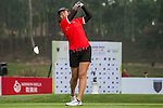 Xinyi He of China tees off at tee one during the 9th Faldo Series Asia Grand Final 2014 golf tournament on March 18, 2015 at Mission Hills Golf Club in Shenzhen, China. Photo by Xaume Olleros / Power Sport Images