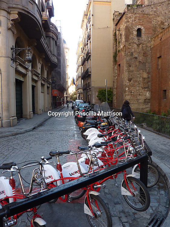 Barcelona, Spain - January 29, 2011:  Bicycles are lined up at a stand.