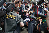 Moscow, Russia, 27/05/2012..Police arrest gay rights organiser Nikolai Alexeyev at an attempted gay pride parade in central Moscow. Several dozen people were arrested during clashes as Russian nationalists attacked gay rights activists during their seventh attempt to hold a gay pride parade in the Russian capital.