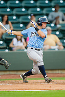 Parker Morin (23) of the Wilmington Blue Rocks follows through on his swing against the Winston-Salem Dash at BB&T Ballpark on August 3, 2013 in Winston-Salem, North Carolina.  The Blue Rocks defeated the Dash 4-2.  (Brian Westerholt/Four Seam Images)