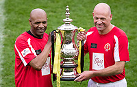 Luther Blissett & Steve Palmer with the winning trophy during the Sellebrity Soccer - Celebrity & legends football match with profits going to Watford Community sports & education trust at Vicarage Road, Watford, England on 12 May 2018. Photo by Andy Rowland.