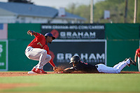 State College Spikes shortstop Moises Castillo (29) tags J.D. Orr (22) sliding into second base during a NY-Penn League game against the Batavia Muckdogs on July 2, 2019 at Dwyer Stadium in Batavia, New York.  Batavia defeated State College 1-0.  (Mike Janes/Four Seam Images)