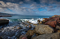 Fine Art Landscape Photograph of a seascape scene in Puerto Vallarta Mexico. The morning lighting was perfect as the long rays of the morning sun brought out the textures and details of clouds, and the ocean waves, and rocky shoreline.