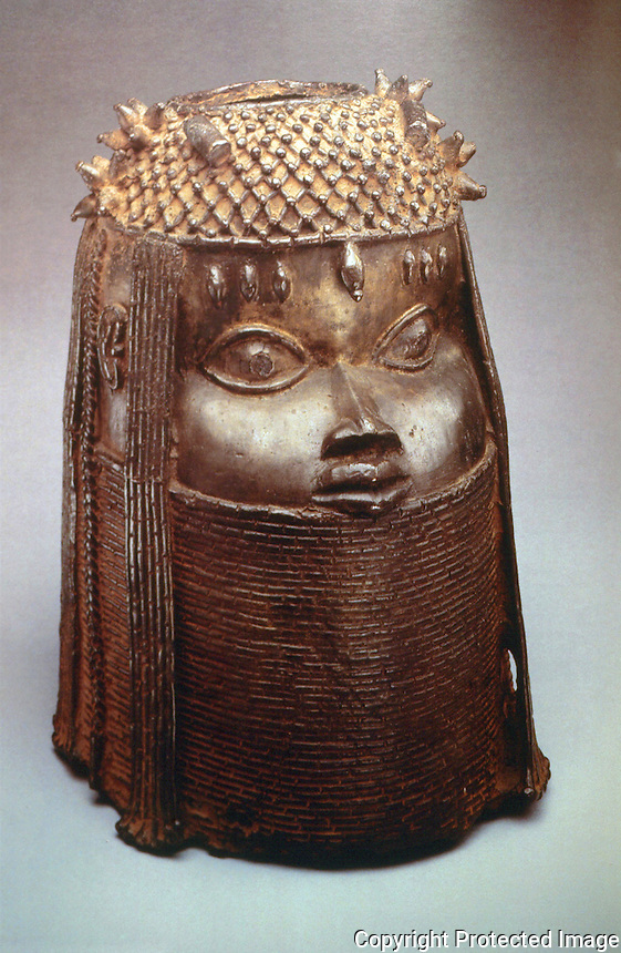 World Civilization:  Benin--Head of an Oba (King), 18th Century. Cast brass heads of Obas placed on alters.  ROYAL ART OF BENIN: THE PERLS COLLECTION.