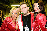 """Dr. Slob"" and two Wingettes in his entourage at the 14th annual Wing Bowl, held in Philadelphia on February 3, 2006 at the Wachovia Center.<br /> <br /> The Wing Bowl is a competitive eating event in which eaters try and down the most hot wings in 30 total minutes in front of a crowd of 10,000 plus people.  The real show however is all around the eaters, from the various scantily clad women (known as ""Wingettes"") that make up eaters' entourages, to the behavior of the fans themselves."