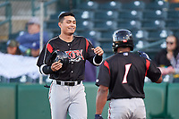 Lake Elsinore Storm right fielder Tirso Ornelas (23) is congratulated by Eguy Rosario (1) after scoring a run during a California League game against the Lancaster JetHawks on April 10, 2019 at The Hanger in Lancaster, California. Lake Elsinore defeated Lancaster 10-0 in the first game of a doubleheader. (Zachary Lucy/Four Seam Images)