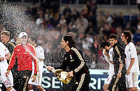 Calcio, Serie A: Roma-Milan. Roma, stadio Olimpico, 7 maggio 2011..Football, Italian serie A: AS Roma vs AC Milan. Rome, Olympic stadium, 7 may 2011..AC Milan forward Filippo Inzaghi sprays wine to teammates at the end of the match to celebrate the winning of the 18th championship..UPDATE IMAGES PRESS/Riccardo De Luca