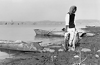 India, Narmada River, Narmada dams and protest movement of NBA Narmada Bachao Andolan, movement to save the Narmada river, and affected Adivasi in their villages, Bargi dam and reservoir, former farmer now struggling for livelihood as fisherman