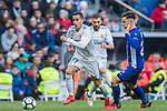 Lucas Vazquez (L) of Real Madrid competes for the ball with Alvaro Medran of Deportivo Alaves during the La Liga 2017-18 match between Real Madrid and Deportivo Alaves at Santiago Bernabeu Stadium on February 24 2018 in Madrid, Spain. Photo by Diego Souto / Power Sport Images