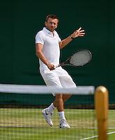 27-06-13, England, London,  AELTC, Wimbledon, Tennis, Wimbledon 2013, Day four, Michal Przysiezny (POL)<br /> <br /> <br /> <br /> Photo: Henk Koster