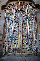 Bali, Indonesia.  Artistic Carving on Door at Entrance to Family Residential Compound.  Klungkung, Semarapura.