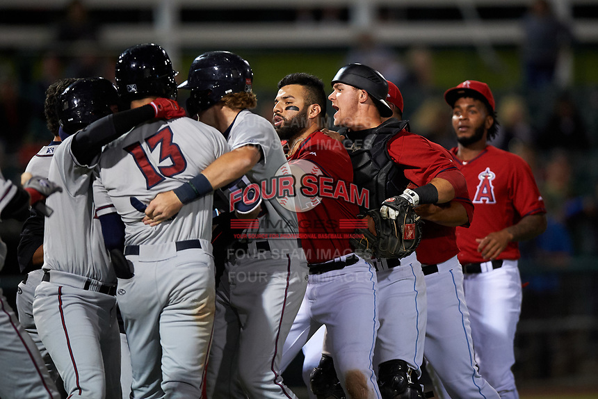 Inland Empire 66ers catcher Jack Kruger (27) breaks up a scuffle between Tyler Nevin (16) and relief pitcher Carlos Salazar (35) during a California League game against the Lancaster JetHawks at San Manuel Stadium on May 18, 2018 in San Bernardino, California. Lancaster defeated Inland Empire 5-3. (Zachary Lucy/Four Seam Images)