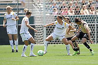LA Sol's Camille Abily moves around FC Gold Pride's Christina Sinclair. The LA Sol defeated FC Gold Pride of the Bay Area 1-0 at Home Depot Center stadium in Carson, California on Sunday April 19, 2009.  .