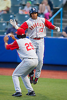 Jhoan Urena (13) of the Brooklyn Cyclones celebrates with teammate Marcos Molina (29) after hitting a game tying home run in the top of the 9th inning against the Hudson Valley Renegades at Dutchess Stadium on June 18, 2014 in Wappingers Falls, New York.  The Cyclones defeated the Renegades 4-3 in 10 innings.  (Brian Westerholt/Four Seam Images)