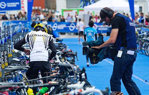 17 JUL 2011 - HAMBURG, GER - A television cameraman films Kathrin Muller (GER) as she prepares in transition for the start of the women's Hamburg round of triathlon's ITU World Championship Series (PHOTO (C) NIGEL FARROW)