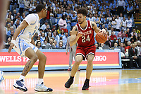 CHAPEL HILL, NC - FEBRUARY 25: Devon Daniels #24 of North Carolina State University is defended by Garrison Brooks #15 of the University of North Carolina during a game between NC State and North Carolina at Dean E. Smith Center on February 25, 2020 in Chapel Hill, North Carolina.