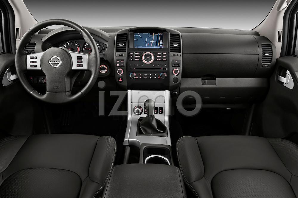 Straight dashboard view of 2010 Nissan Navara LE 4 door Pick-Up Truck Stock Photo