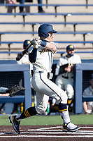 Michigan Wolverines second baseman Riley Bertram (12) follows through on his swing against the Michigan State Spartans on March 21, 2021 in NCAA baseball action at Ray Fisher Stadium in Ann Arbor, Michigan. Michigan scored 8 runs in the bottom of the ninth inning to defeat the Spartans 8-7. (Andrew Woolley/Four Seam Images)