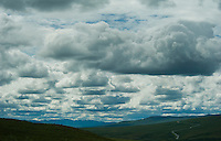 The Denali Highway, a two-lane gravel road, winds through the tundra.
