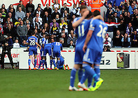 Sunday, 13 April 2014<br /> Pictured L-R: Oscar, John terry and Gary Cahill of Chelsea (in the foreground) celebrating the goal score by their team mate Demba Ba who is mobbed my team mates in the far dostance. <br /> Re: Barclay's Premier League, Swansea City FC v Chelsea at the Liberty Stadium, south Wales,