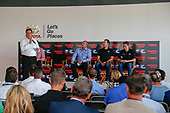 Toyota executives Ed Laukes and David Wilson, and Toyota Racing drivers Kyle Busch and Christopher Bell