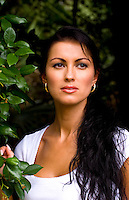 Beautiful hispanic woman from Estonia in Eastern Europe portrait with plants showing beautiful eyes and face
