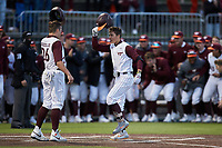 Tanner Schobel (8) of the Virginia Tech Hokies is greeted at home plate by teammate Kevin Madden (26) after hitting a home run against the Georgia Tech Yellow Jackets at English Field on April 16, 2021 in Blacksburg, Virginia. (Brian Westerholt/Four Seam Images)
