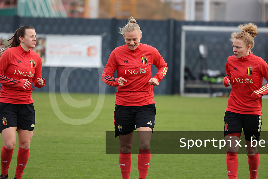 Hannah Eurlings, Ella Van Kerkhoven and Charlotte Tison pictured during the training session of the Belgian Women's National Team ahead of a friendly female soccer game between the national teams of Germany and Belgium , called the Red Flames in a pre - bid tournament called Three Nations One Goal with the national teams from Belgium , The Netherlands and Germany towards a bid for the hosting of the 2027 FIFA Women's World Cup ,on 19th of February 2021 at Proximus Basecamp. PHOTO: SEVIL OKTEM | SPORTPIX.BE