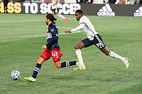 FOXBOROUGH, MA - OCTOBER 19: Cory Burke #19 of Philadelphia Union comes in to tackle DeJuan Jones #24 of New England Revolution during a game between Philadelphia Union and New England Revolution at Gillette on October 19, 2020 in Foxborough, Massachusetts.