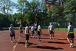 "American soldiers warm up before playing the Poles in a basketball game during a day off for cultural activities, which included sports games between the different participating armies in the NATO ""Saber Strike"" military exercises, in Drawsko Pomorskie, Poland on June 13, 2015.  NATO is engaged in a multilateral training exercise ""Saber Strike,"" the first time Poland has hosted such war games, involving the militaries of Canada, Denmark, Germany, Poland, and the United States."