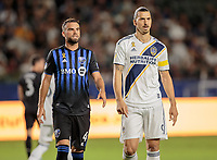CARSON, CA - SEPTEMBER 21: Rudy Camacho #4 of Montreal Impact and Zlatan Ibrahimovic #9 of the Los Angeles Galaxy during a game between Montreal Impact and Los Angeles Galaxy at Dignity Health Sports Park on September 21, 2019 in Carson, California.