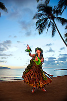 Kahiko hula dancer on the beach at Haleiwa on Oahuʻs north shore.
