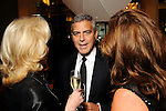 George Clooney chats with Lynn Wyatt and Cherie Flores before his appearance at the Brilliant Lecture Series at the Wortham Theater Thursday May 3,2012. (Dave Rossman Photo)