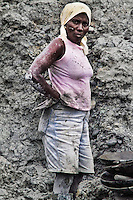 A Colombian woman miner works in the Agua Clara opencut near Tadó, Chocó dept., Colombia, 26 May 2004. Chocó is a no man's land. The large inaccessible rainforest jungle area in the western lowlands of Colombia is mainly inhabited by Afro Colombian population, descendents of African slaves. High presence of malaria, guerilla drug traffic routes, tropical deseases and only an irregular river transport makes this region virtually lost. Gold that is found in the jungle rivers of Chocó is the only hope for many although they never find what they dream about.