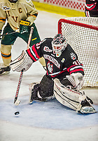 17 December 2013:  Northeastern University Huskies Goaltender Clay Witt, a Redshirt Junior from Brandon, FL, makes a third period save against the University of Vermont Catamounts at Gutterson Fieldhouse in Burlington, Vermont. Witt recorded a shut out as the Huskies defeated the Catamounts 3-0 to end UVM's 5 game winning streak. Mandatory Credit: Ed Wolfstein Photo *** RAW (NEF) Image File Available ***
