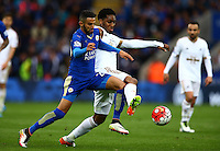 Riyad Mahrez of Leicester City challenges Leroy Fer of Swansea City during the Barclays Premier League match between Leicester City and Swansea City played at The King Power Stadium, Leicester on 24th April 2016