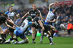 Ospreys replacement scrum half Tito Tebaldi kicks the ball away under pressure from Connacht pair John Muldoon and Conor Gilsenan.<br /> RoboPro 12<br /> Ospreys v Connacht<br /> 10.05.14<br /> ©Steve Pope-SPORTINGWALES