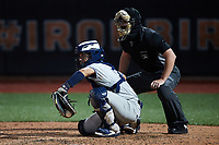 Hudson Valley Renegades catcher Anthony Seigler (20) receives a pitch as home plate umpire Adam Pierce looks on during the game against the Aberdeen IronBirds at Leidos Field at Ripken Stadium on July 23, 2021, in Aberdeen, MD. (Brian Westerholt/Four Seam Images)